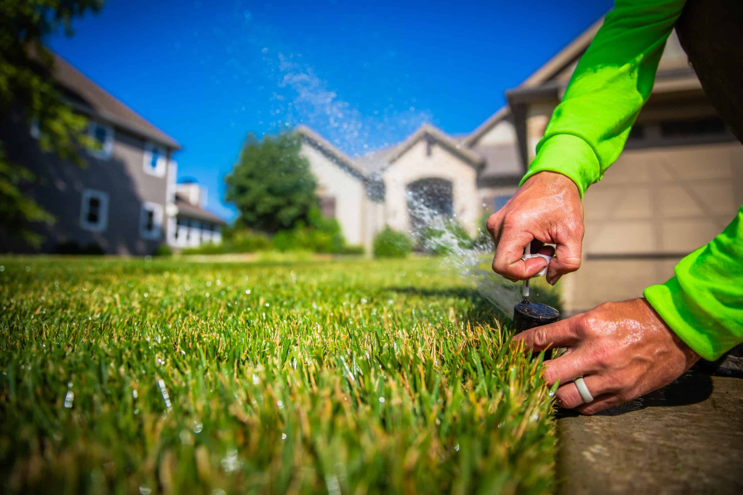 Man turning on an lawn irrigation system